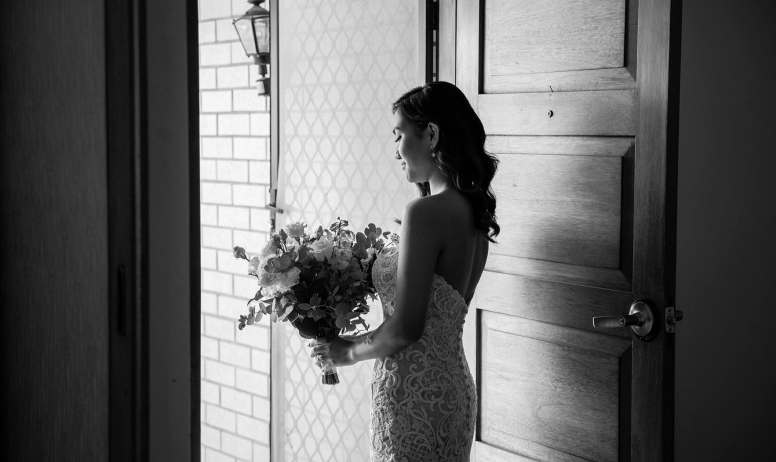 bride walking out front door BW