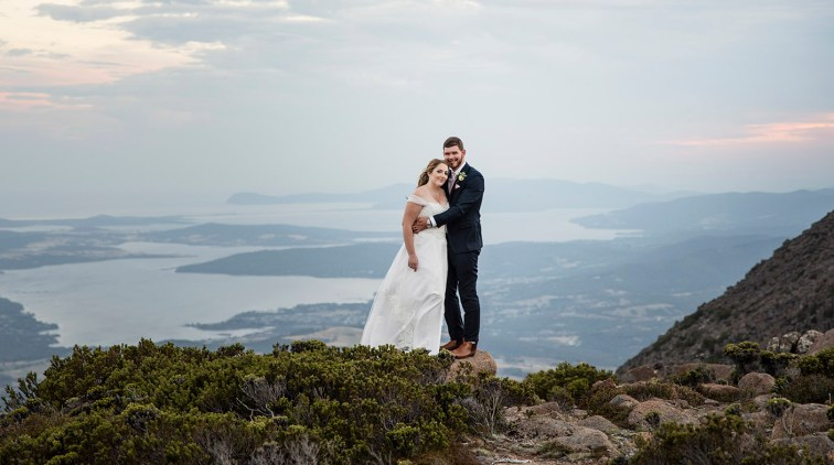Bride and groom on a mountain