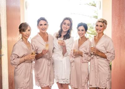 bridesmaids having fun in gown