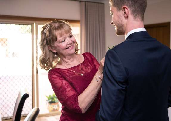 Smiling Mum as she helps with tie
