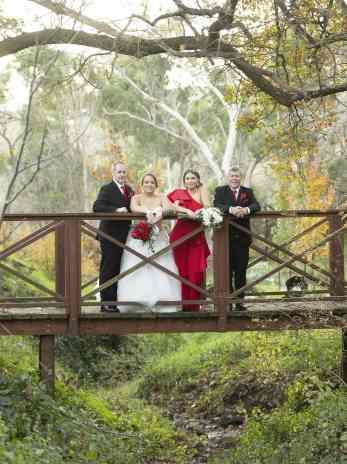 bridal party on the wooden bridge