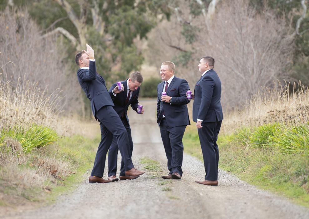 groom and groomsmen having fun on driveway