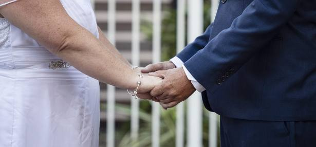 Holding hands at wedding ceremony