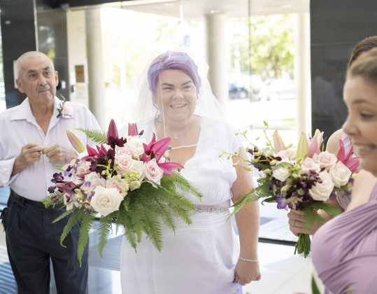 Smiling bride in the Doubletree by Hilton lobby