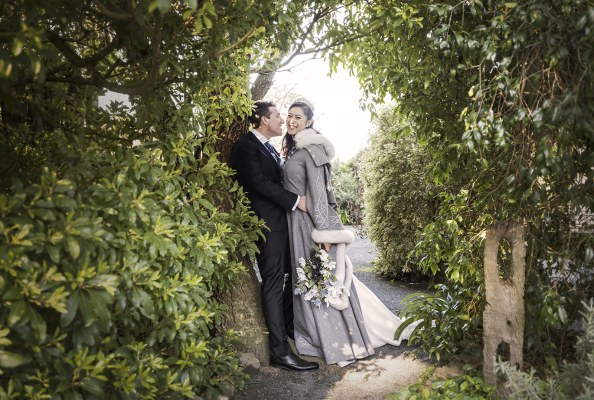 Bride and groom amongst the foliage