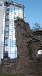 Swansea, Wales sits along the country's southwest coast, just over an hour from the capital. The city's castle lies in ruins in front of a tall contemporary building, the stark contrast showing the modern day's domination over medieval times.