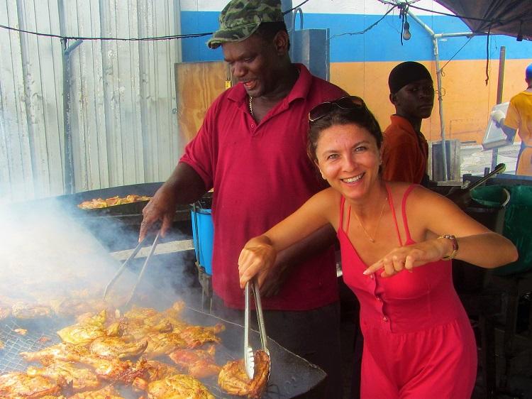 Melek helping cook some chicken