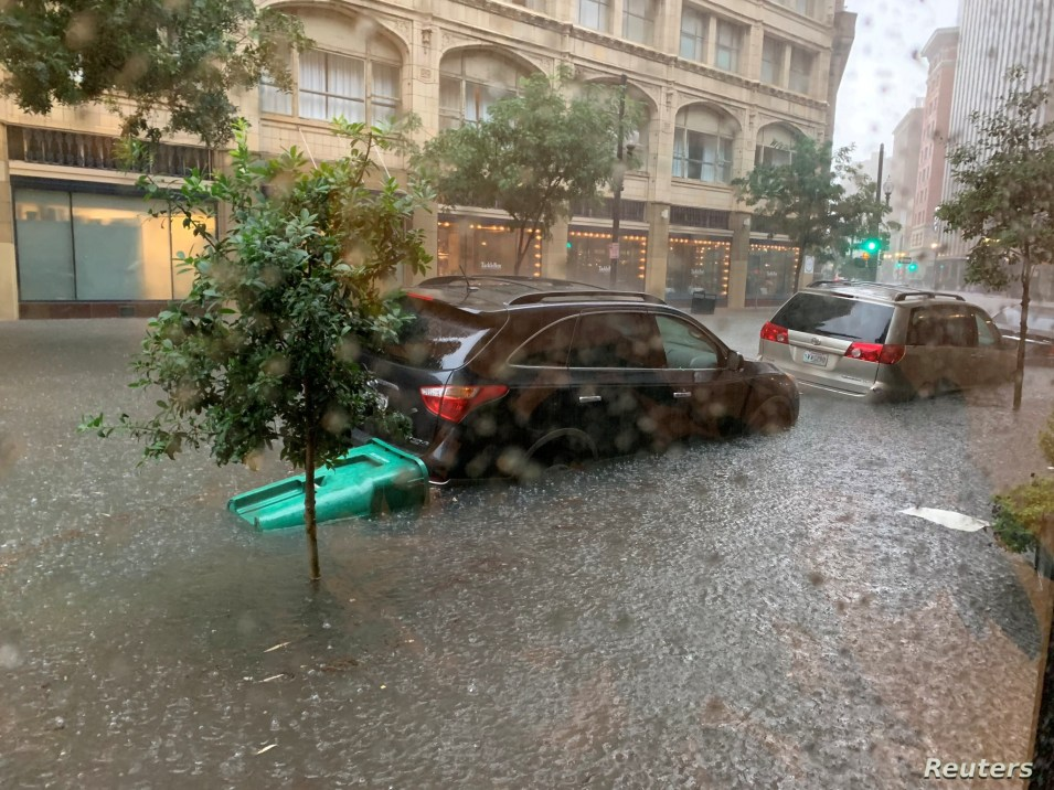 Vehicles sit in high waters after heavy rain in New Orleans, Louisiana, July 10, 2019, in this image obtained from social media.
