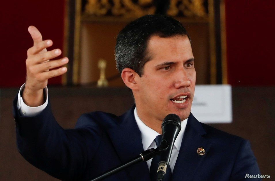 Venezuelan opposition leader Juan Guaido, who many nations have recognized as the country's rightful interim ruler, gestures as he speaks during a session of Venezuela's National Assembly at a public square in Caracas, Venezuela, July 23, 2019..