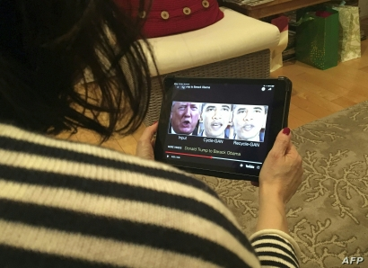 A woman in Washington, DC, views a manipulated video on January 24, 2019, that changes what is said by President Donald Trump an