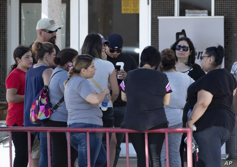 Relatives of victims of the Walmart mass shooting wait for information from authorities at the reunification center in El Paso, Texas,  Aug. 4, 2019.