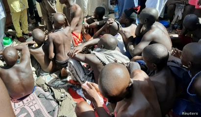 Men and boys are pictured after being rescued by police in Sabon Garin, in Daura local government area of Katsina state,…
