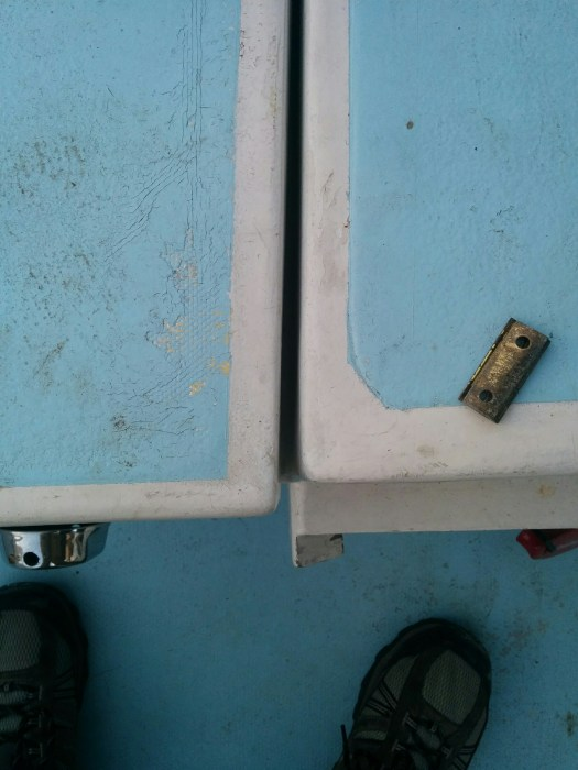 how the old hinges had it lined up. It looks better with the hinge on top.