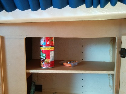 The middle shelf will hold a 6x3 can, with most of those being able to stack two high. The bottom part can do 3x4x2, with 2x2x2.