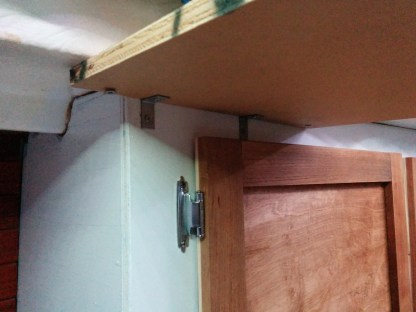 Stainless steel angle brace to help hold the shelf up.