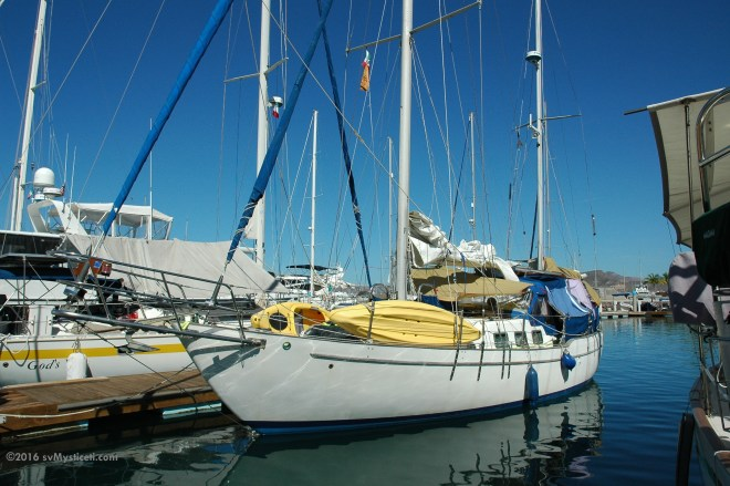 """Mysticeti"" in La Paz Marina.  We've tried to shield the cockpit from the brutal sun."