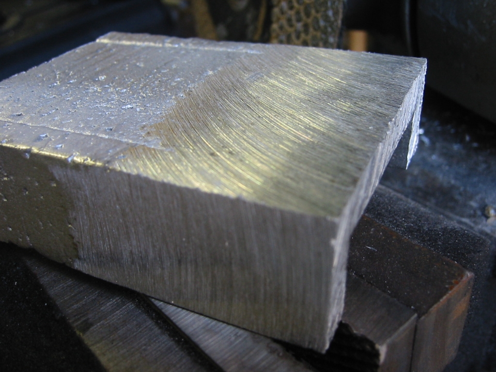 (20) Sanding the foam with 400 grit sandpaper helps smooth the  surface.  The remainder of the texture left by the foam can be   removed with a grinding disk.