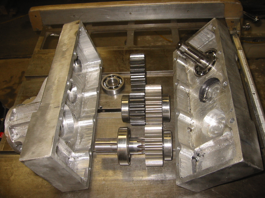 (14) Completed gearbox with the drive shafts, bearings, and  spur gears.