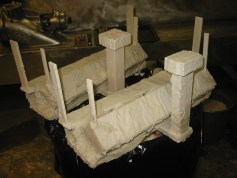 (1) Plaster and silica investment applied to exhaust manifolds.