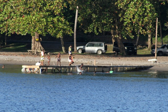 local kids having sunday fun on the dock