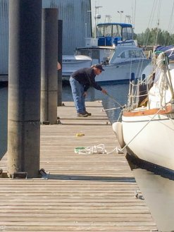 Shawn at the marina checking out the keel shape