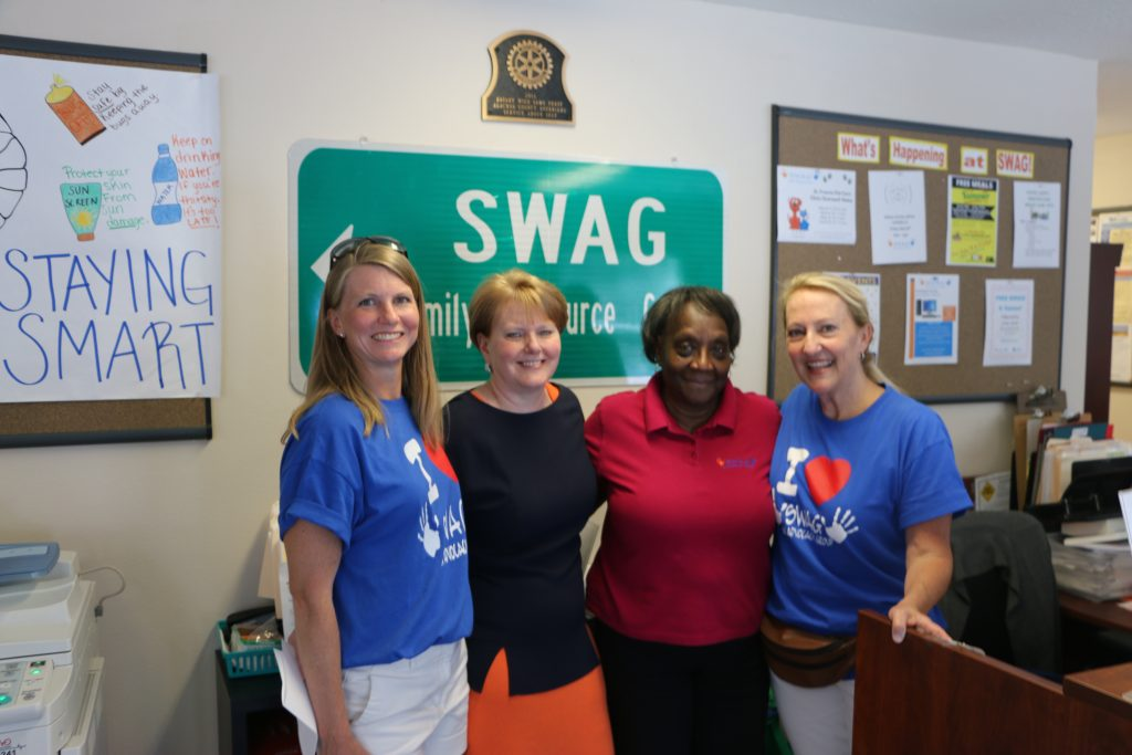 SWAG leaders stand with a partner in the SWAG Family Resource Center during the CHILD Center's breaking ground celebration.