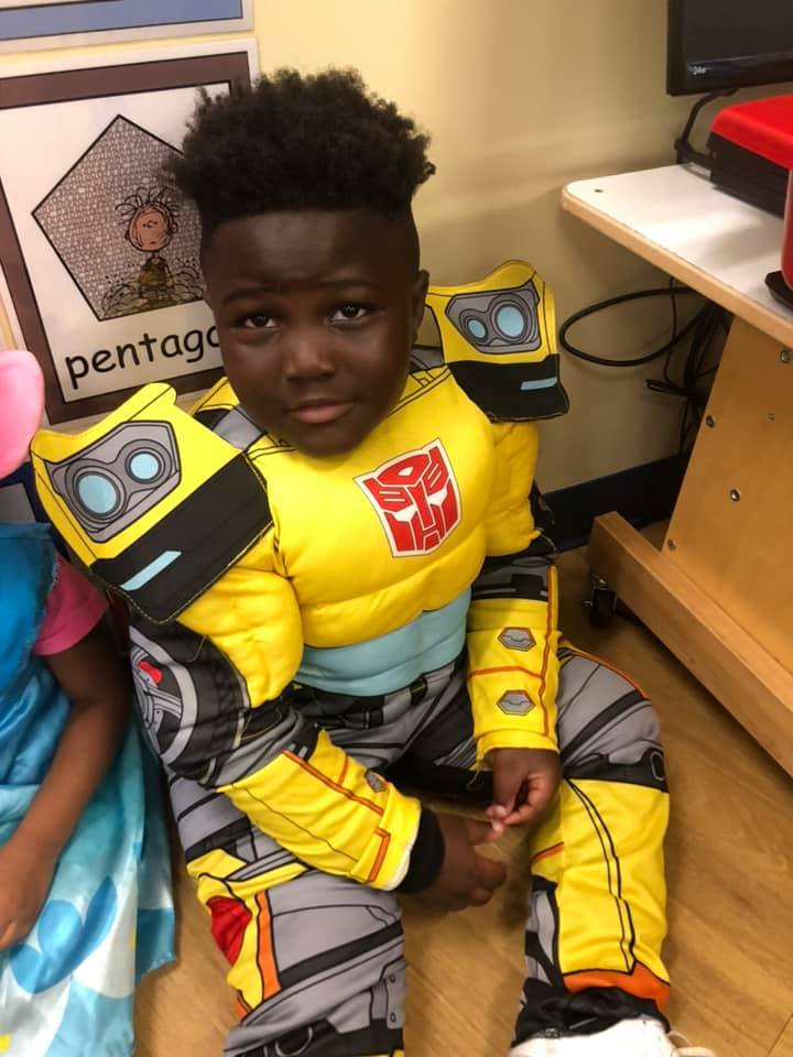 A CHILD Center student wearing a Transformers costume