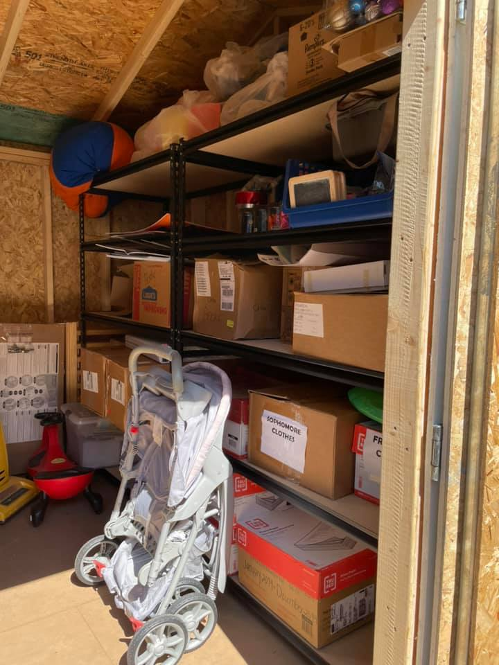 Filled storage shelves in the utility shed at the CHILD Center