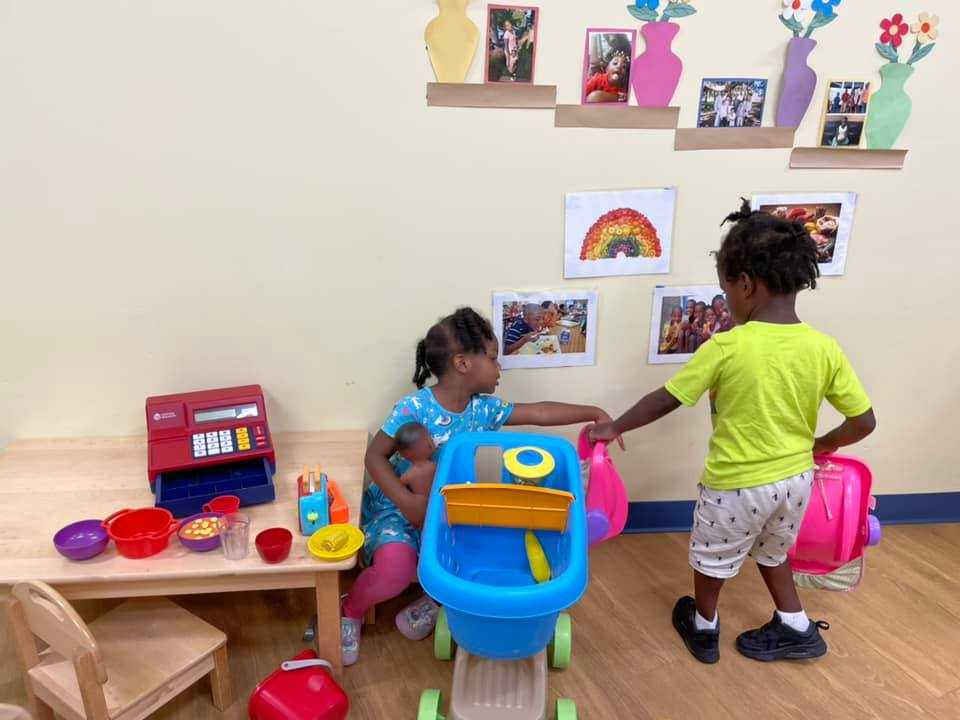 Two children play together inside the CHILD Center