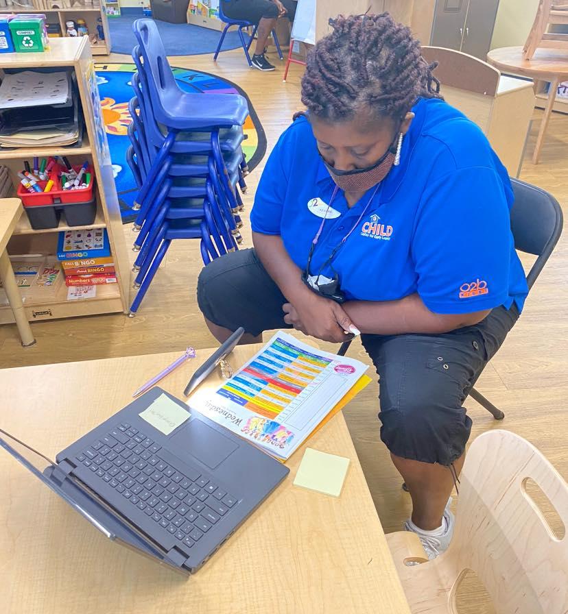 A CHILD Center staff member reads through training materials during the Summer 2021 teacher training