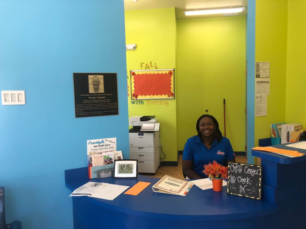 CHILD Center staff member Summer at the CHILD Center front check-in desk