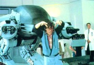 "Paul Verhoeven gives ED-209 his motivation on the set of ""RoboCop,"" 1986."