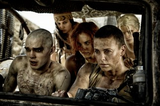 "NICHOLAS HOULT as Nux, COURTNEY EATON as Fragile, RILEY KEOUGH as Capable, CHARLIZE THERON as Furiosa and ABBEY LEE KERSHAW as Wag in Warner Bros. Pictures' and Village Roadshow Pictures' action adventure ""MAD MAX: FURY ROAD,"" a Warner Bros. Pictures release. (Jasin Boland)"