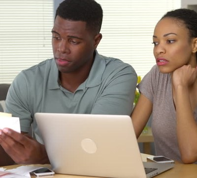 black couple looking at finances resize