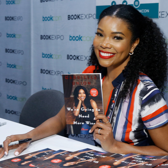 """NEW YORK, NY - JUNE 01: Gabrielle Union signs copies of her new book, """"We're Going To Need More Wine"""" during the BookExpo 2017 at Javits Center on June 1, 2017 in New York City. (Photo by John Lamparski/Getty Images)"""
