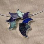 Pendant necklace inlayed with semi-precious stones
