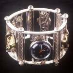 Bracelet in the form of garden fence, with watch faces set on trellis', done in sterling silver with moonstones.