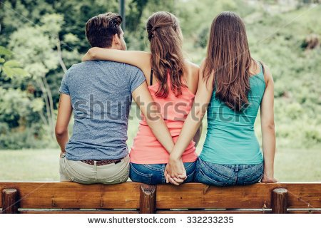 stock-photo-love-triangle-a-girl-is-hugging-a-guy-and-he-is-holding-hands-with-another-girl-they-are-sitting-332233235