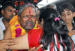 Rescued pilgrims being received by family members on their return in Allahabad on Saturday from flood-devastated Uttarakhand