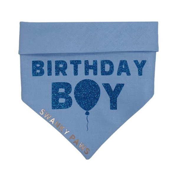 """Birthday Boy"" dog bandana with a blue cotton fabric and gittery blue vinyl for the text. Perfect for any dogs birthday celebrations"