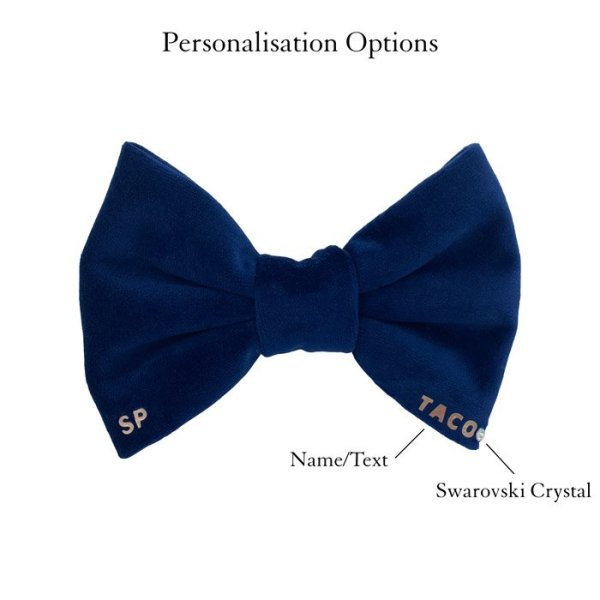 Navy blue dog bow tie personalised. At the bottom right it has the dogs name and Swarovski crystal on a luxury soft velvet