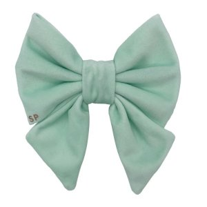 Pastel green sailor dog bow front side showing off the beautiful velvet shine