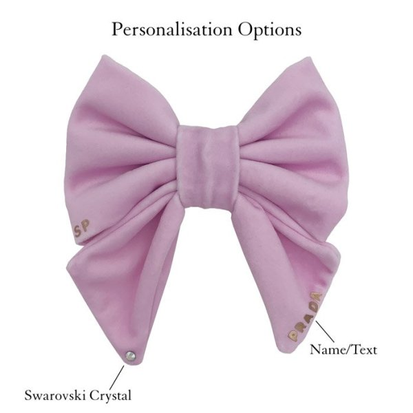 Pastel pink dog sailor bow tie personalised. This one shows the swarovski crystal at the bottom left and the dogs name done in vinyl at the bottom right in a shiny rose gold