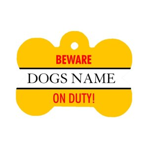 """Personalised pet id tag with a yellow background and """"Beware On Duty"""" red writing on the front of the tag"""
