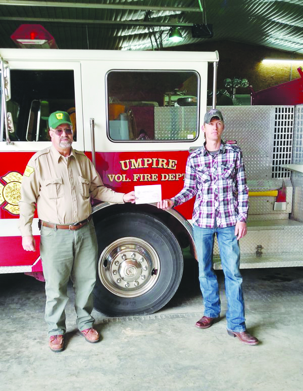 From left to right, John Crump, AFC County Ranger and Cohen Davis, Umpire VFD Fire Chief.
