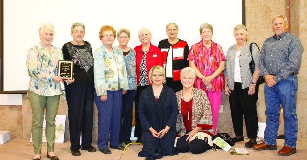 The Montgomery County Nursing Home Ladies Auxiliary Thrift Store was chosen to be the 2016 Mount Ida Area Chamber of Commerce Non-Profit Organization of the Year. Pictured left to right: Anita Watson, Mae Minton, Pat Hopper, Maurene Tanner, Jeneva Robbins, Jackie Cox, Judy Carlton, Helen Daniels, Tommie Johnston; (kneeling) Sherrie Morris andLinda West.