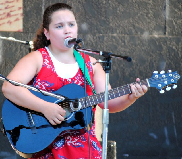 Allie Westbrook sings at the Stand Up for America celebration.
