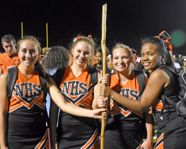 Senior cheerleaders McKenzie Morphew, Nicole Dodson, Chelsey Hile, and Asia Harris make sure the stick is taken care of after the game.