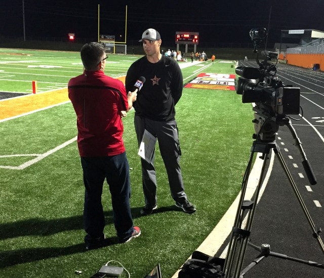 Coach Mike Volarvich answers questions during an interview by Fox 16 in Little Rock  following the Scrappers' Homecoming win last Friday night.