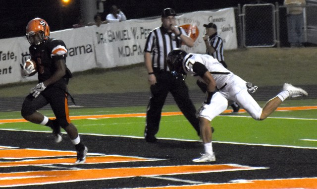 Trent Harris (6) outruns Corey Page of Joe T. Robinson for a Scrapper touchdown in the first quarter of Friday night's victory.